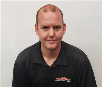 SERVPRO employee, Patrick Belcher, male in front of white background