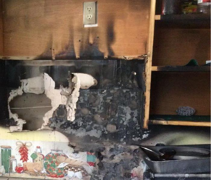 Fire damage to portion of household kitchen
