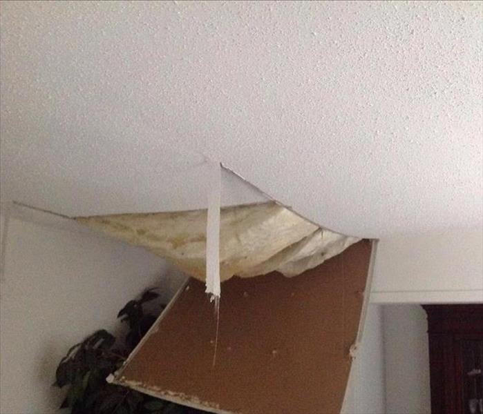 Evidence of water damage in ceiling